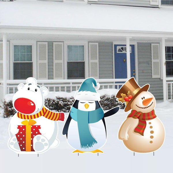 A polar bear, a penguin, and a snowman. Christmas Yard Decorations