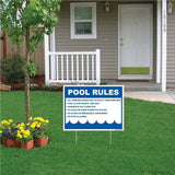 A yard sign that has a list of pool rules