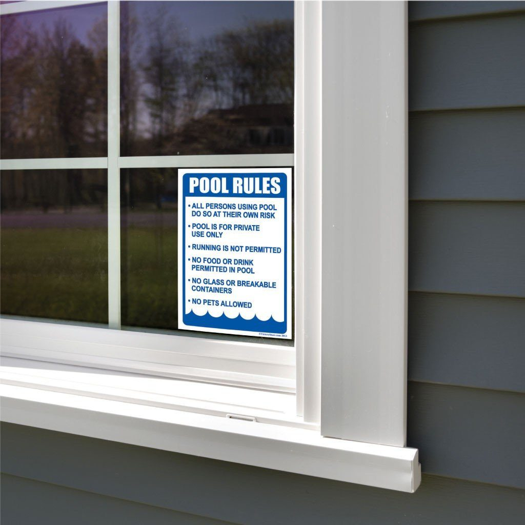 A pool rules sticker on a window