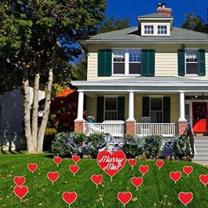 "Marry Me Red Heart Yard Decoration - 18 Flat Plain Hearts & 1 Flat Larger Heart with ""Marry Me?"" Printed on It 2 EZ stakes and 18 short stakes"