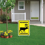 "A yard sign that says ""Reindeer crossing"""