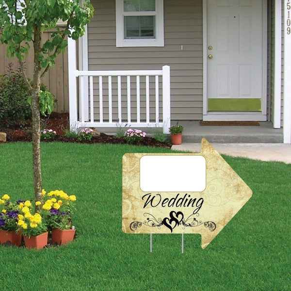 The front yard of a house with a wedding decoration arrow