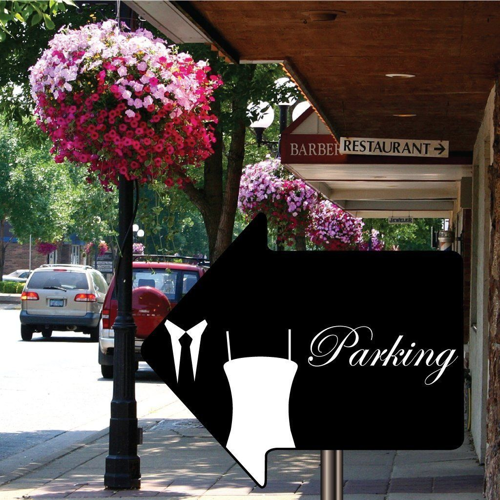 A wedding decoration arrow sign that says parking