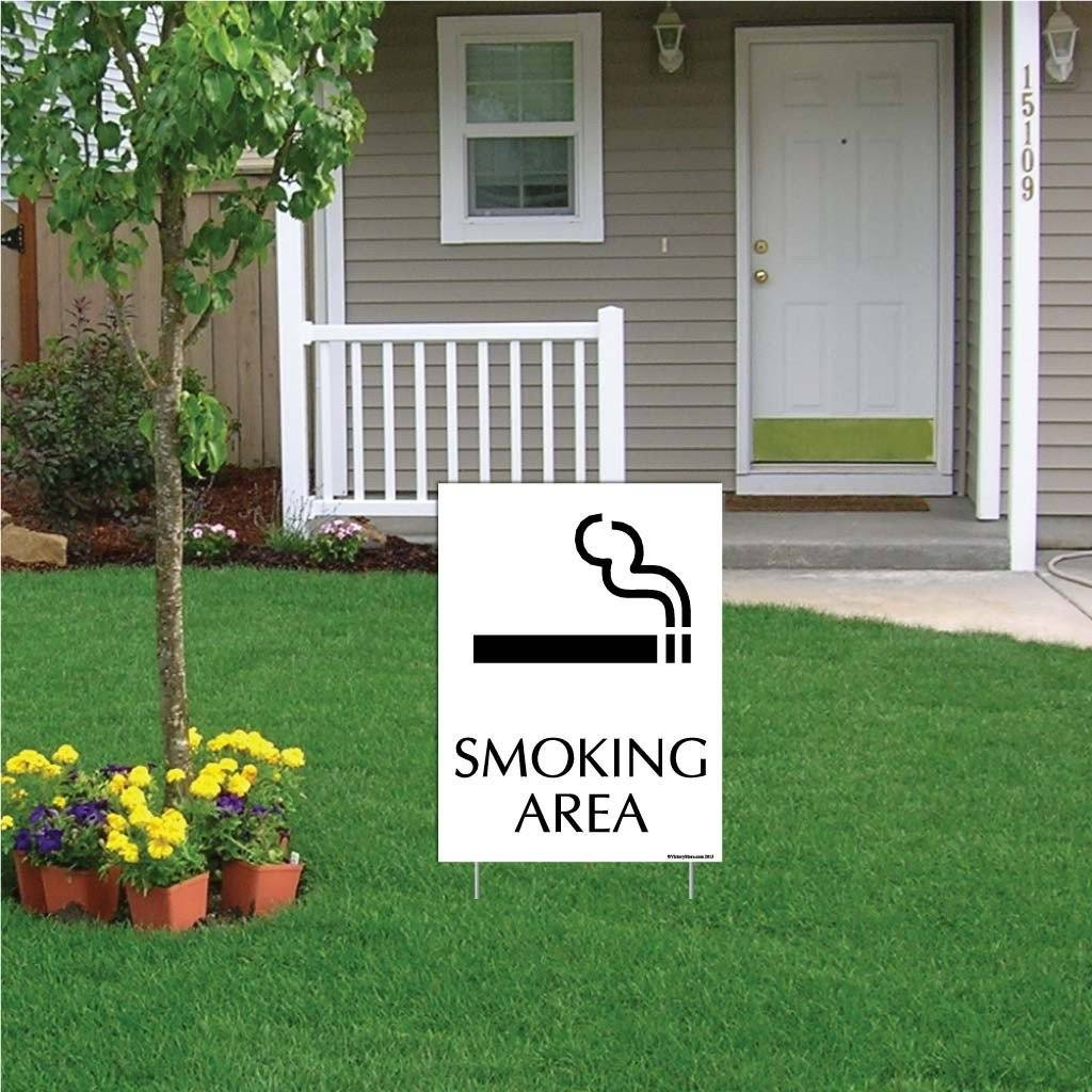 "A yard sign that says ""Smoking Area"""