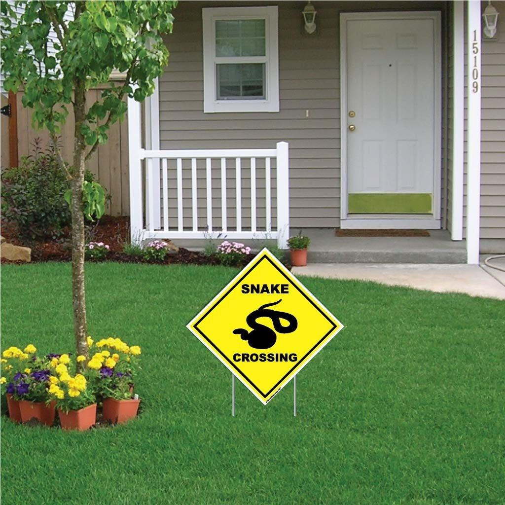 "A yard sign that says ""Snake Crossing"""