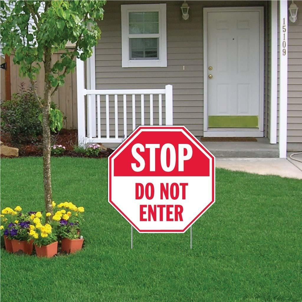 "A yard sign that says ""Stop, Do not enter"""