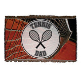 A tennis themed throw blanket