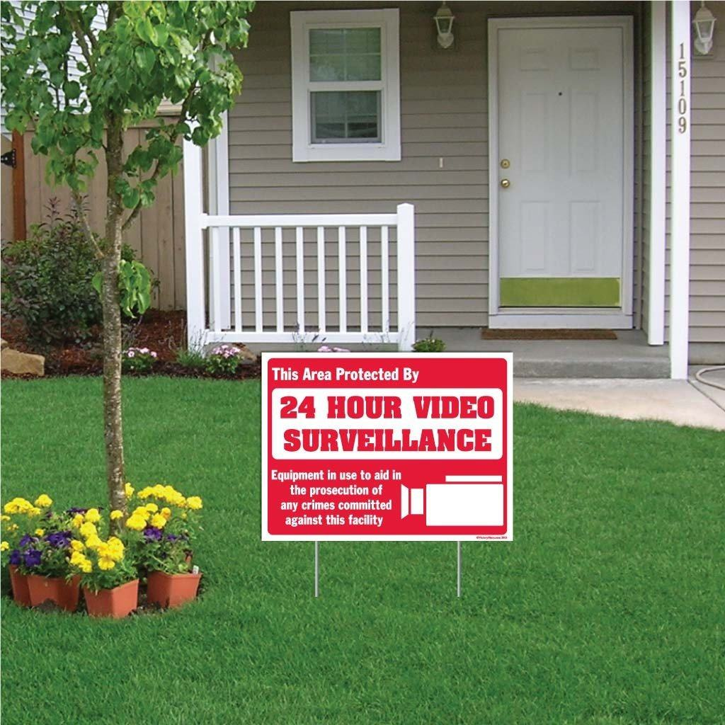 "A yard sign that says ""This area protected by 24 hour video surveillance"""