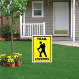 "A yard sign that says ""Trail Crossing"""