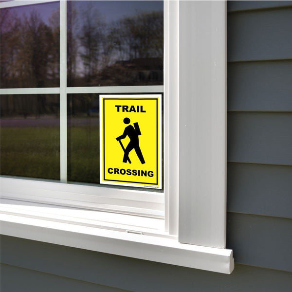 A trail crossing sticker on a window