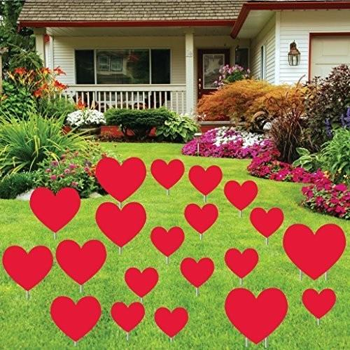 Red Valentine's day hearts in the front yard of a house