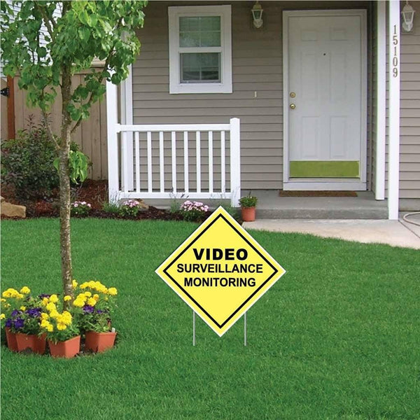 "A yard sign that says ""Video Surveillance monitoring"""