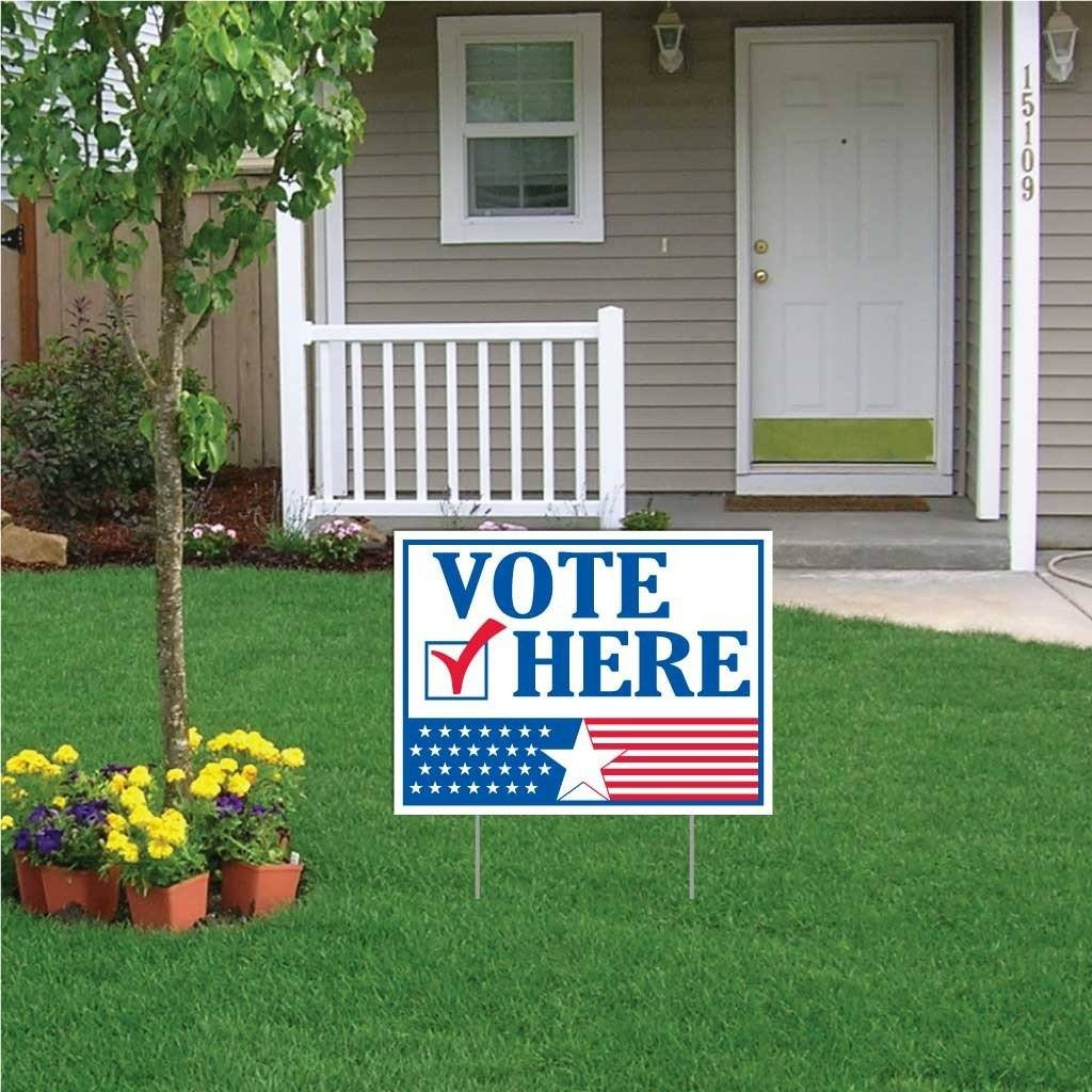 A yard sign in front of a yard