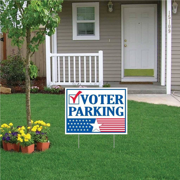 A yard sign in the front of a house