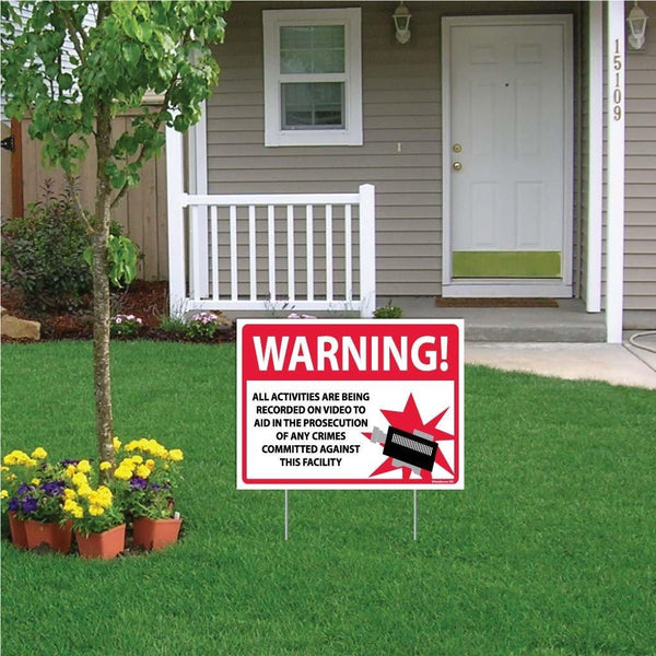 "A yard sign that says ""Warning, all activities are being recorded on video to aid in the prosecution of any crimes committed against this facility"""