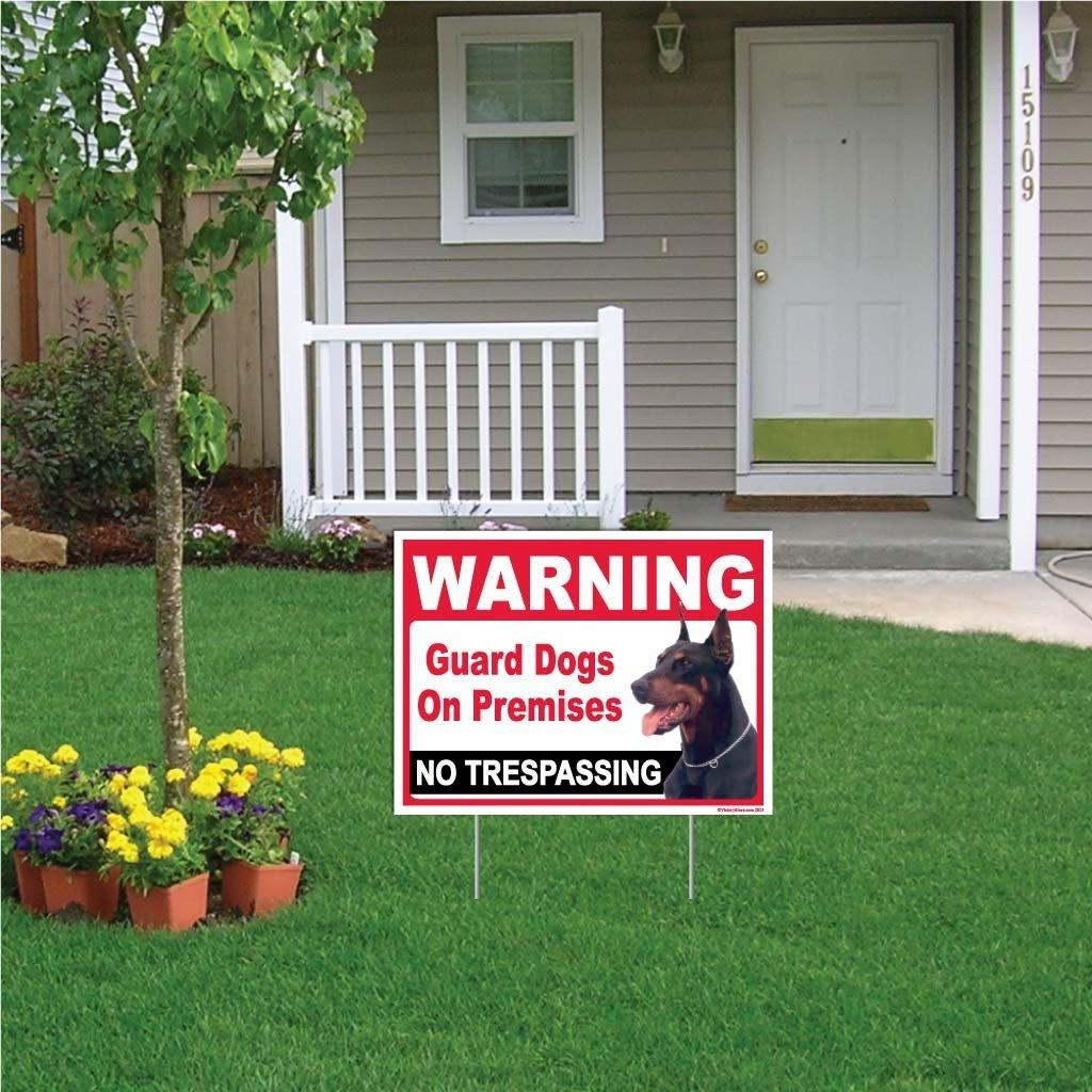 A yard sign that warns of an attack dog