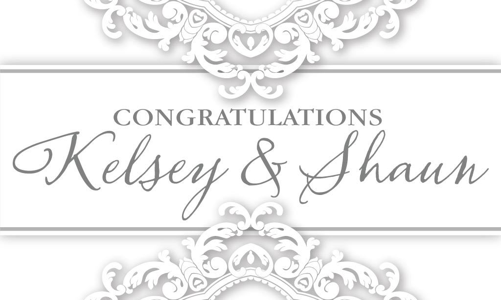 A white and black wedding banner