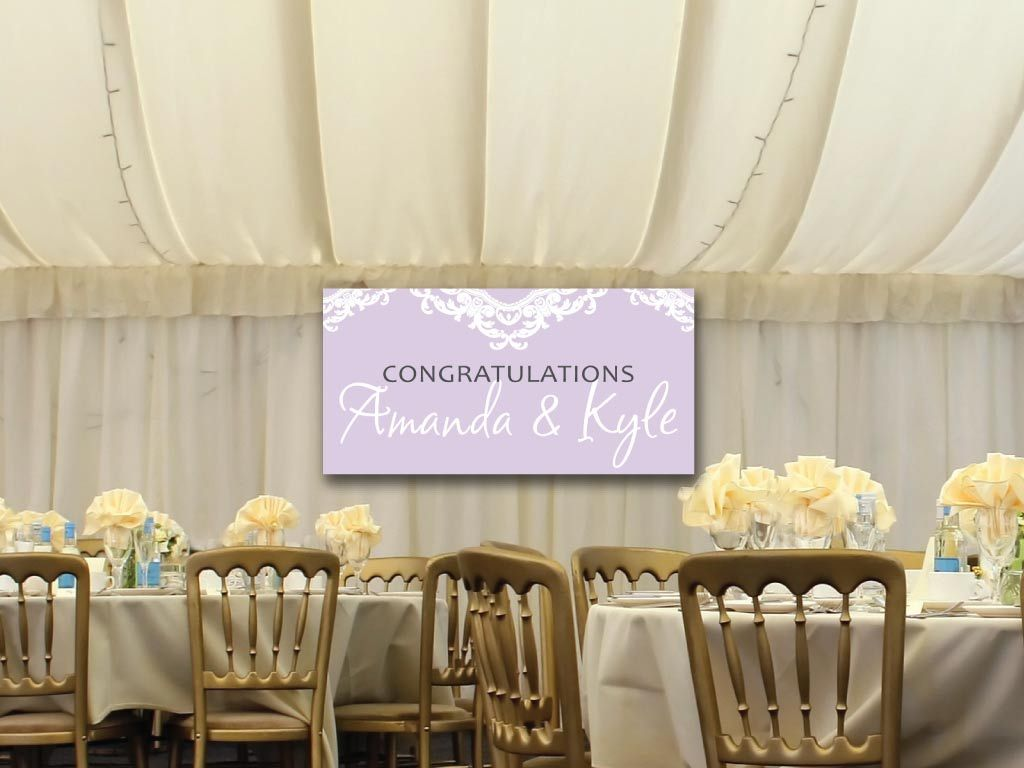 a custom printed wedding banner handing on a wall