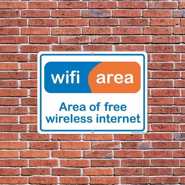 A free wifi sign on a brick wall