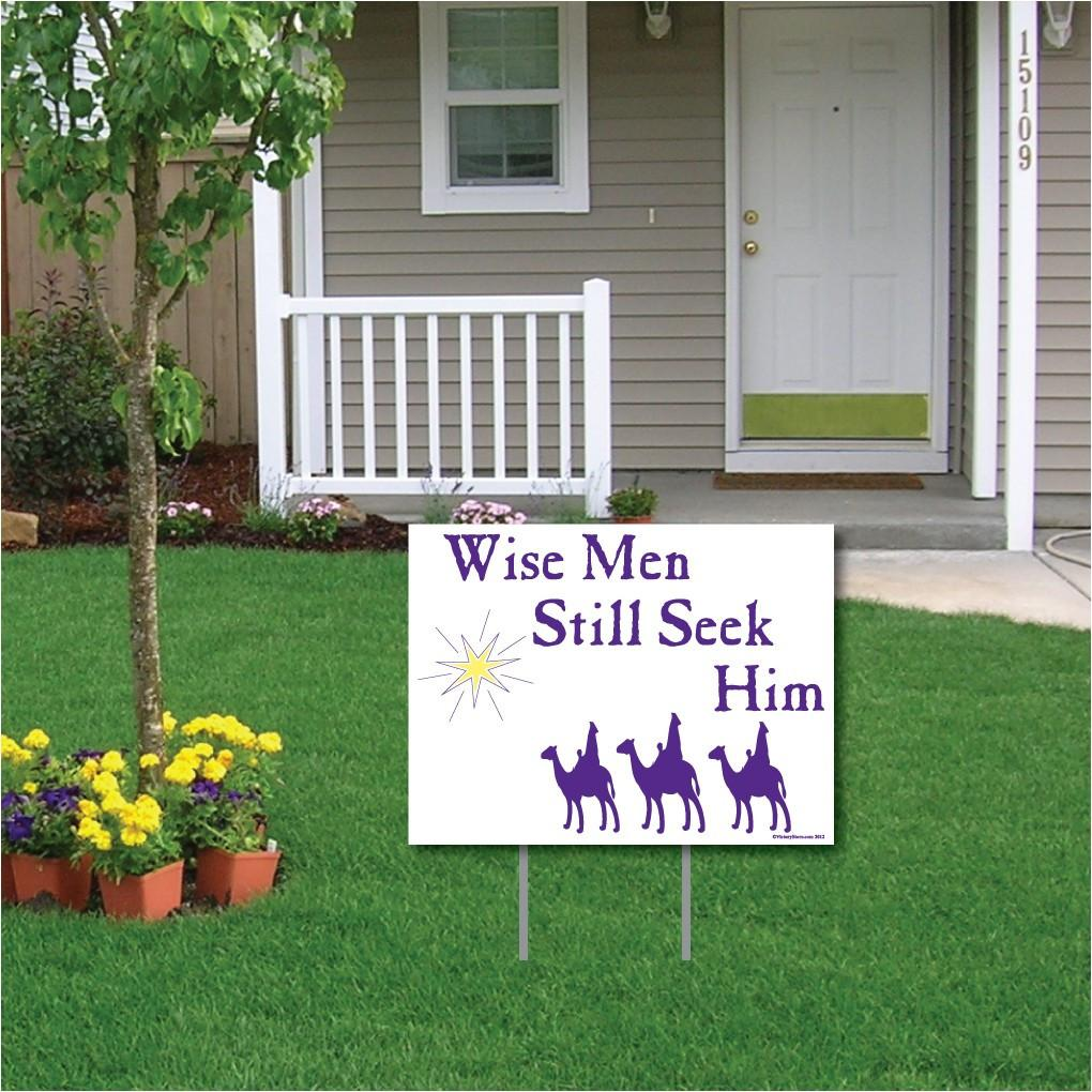 "The front yard of a house with text that says ""Wise men still seek him"""