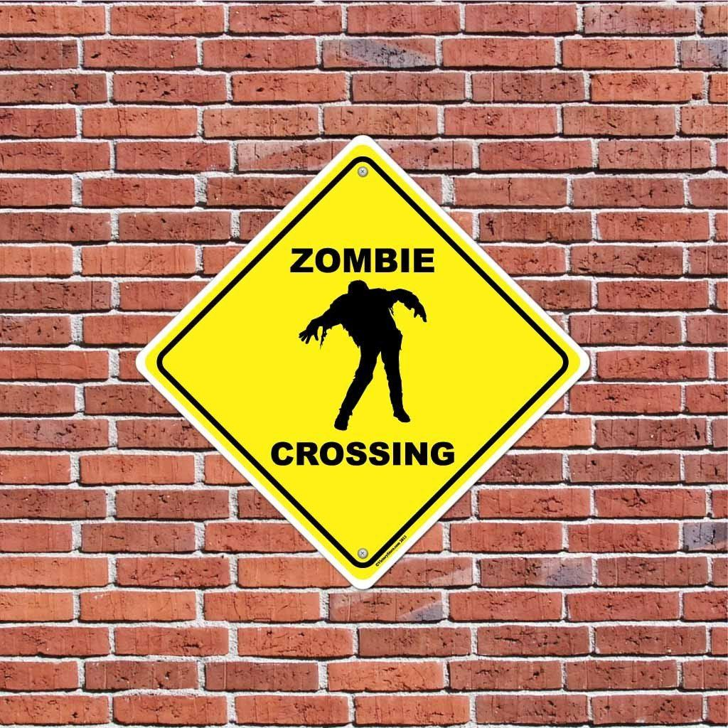 A zombie crossing sign that is on a brick wall