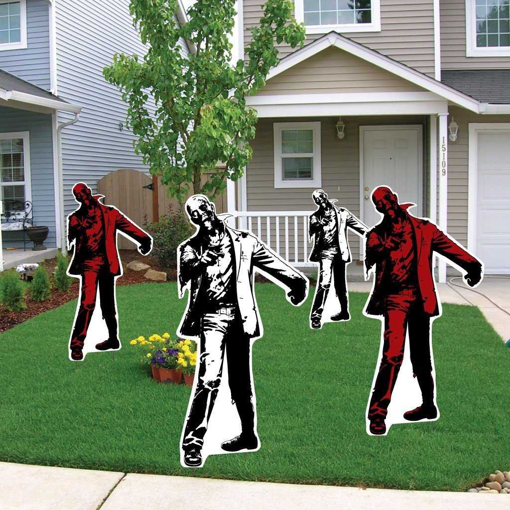 Front yard of a house with 4 zombie yard decorations