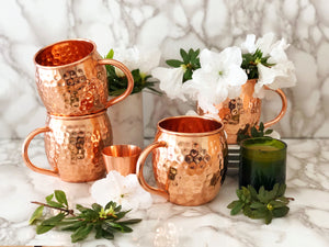 Set of 4 Moscow Mule Copper Cups and Shot Glass by Urban Vintage LA with White Flowers and Marble Background