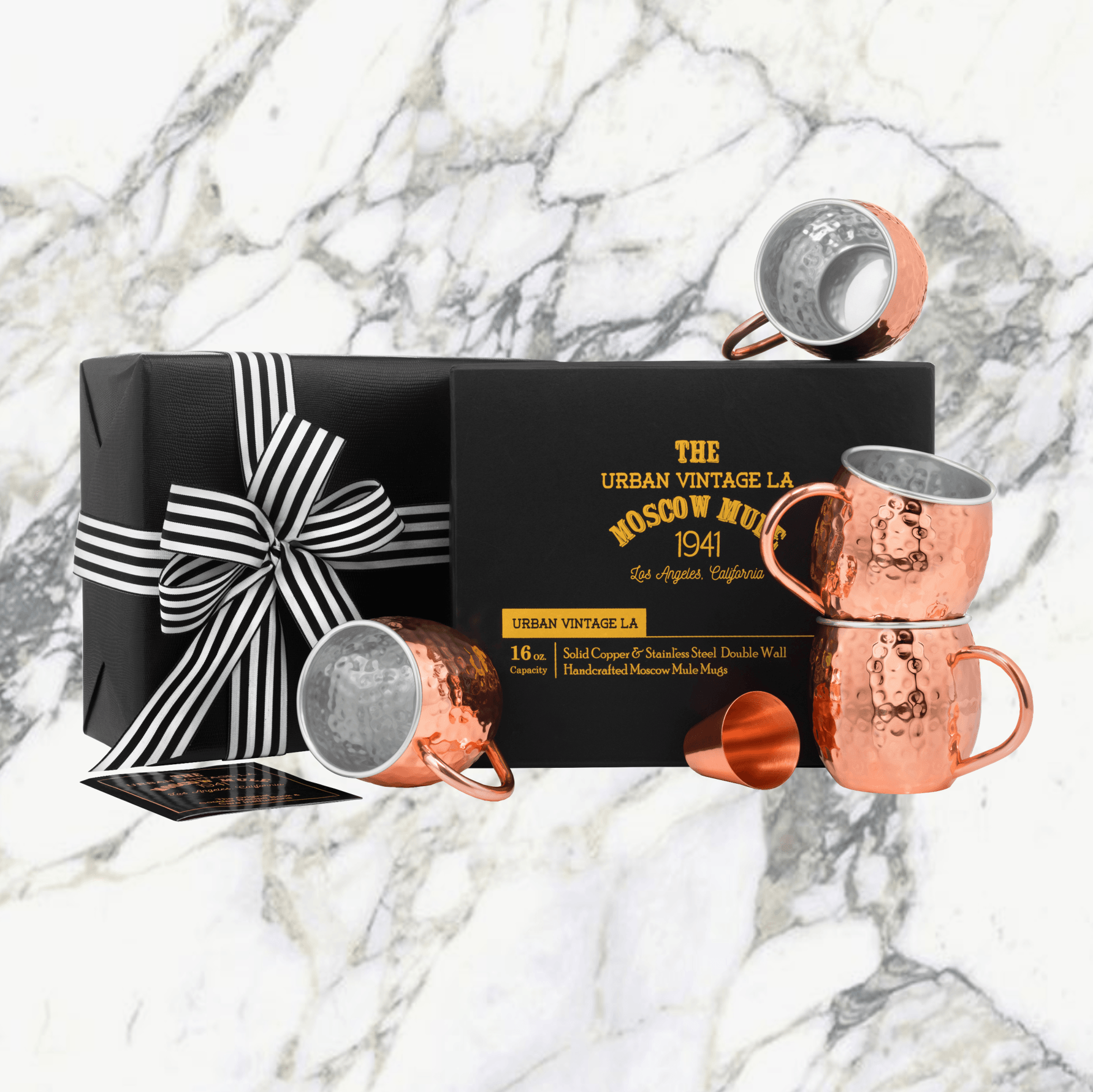 Urban Vintage LA Set of 4 Lined Copper And Stainless-Steel Mugs In Black Gift Box With Gift Wrapped Box in Background With Black and White Ribbon