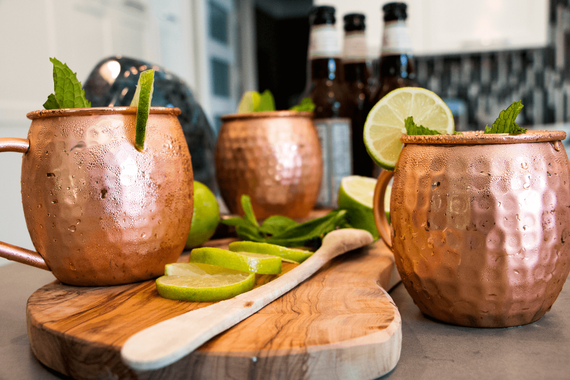 Urban Vintage LA Moscow Mule Copper Mugs in Kitchen Showing Preparation of Moscow Mule Cocktail with Kitchen in Background
