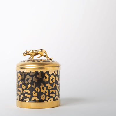 black and gold printed candle with leopard figure as handle by L'Objet at Secret Location