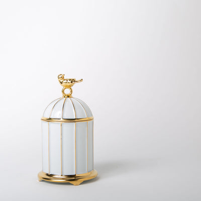 white and gold birdcage candle by L'Objet at Secret Location