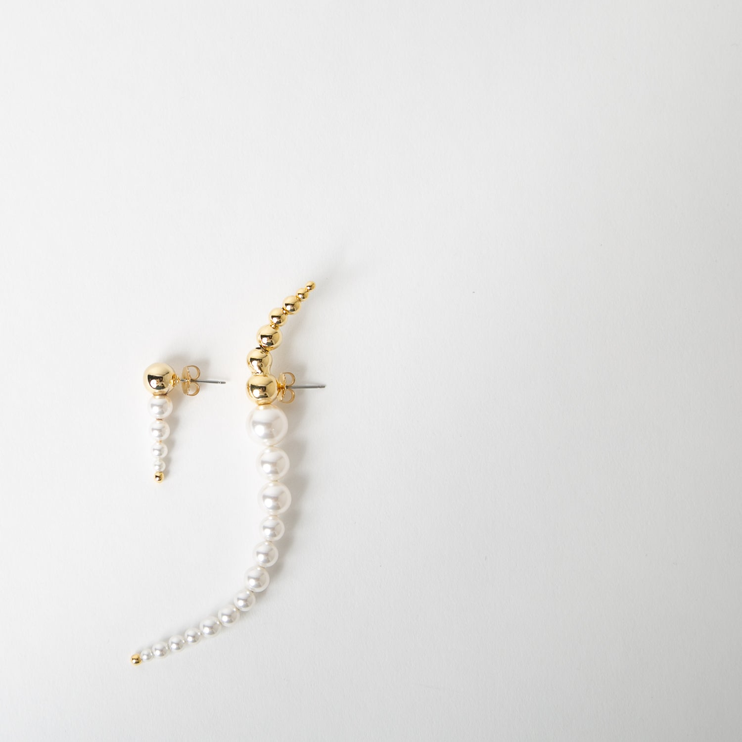 gold and pearl asymmetric earring by Joomi Lim