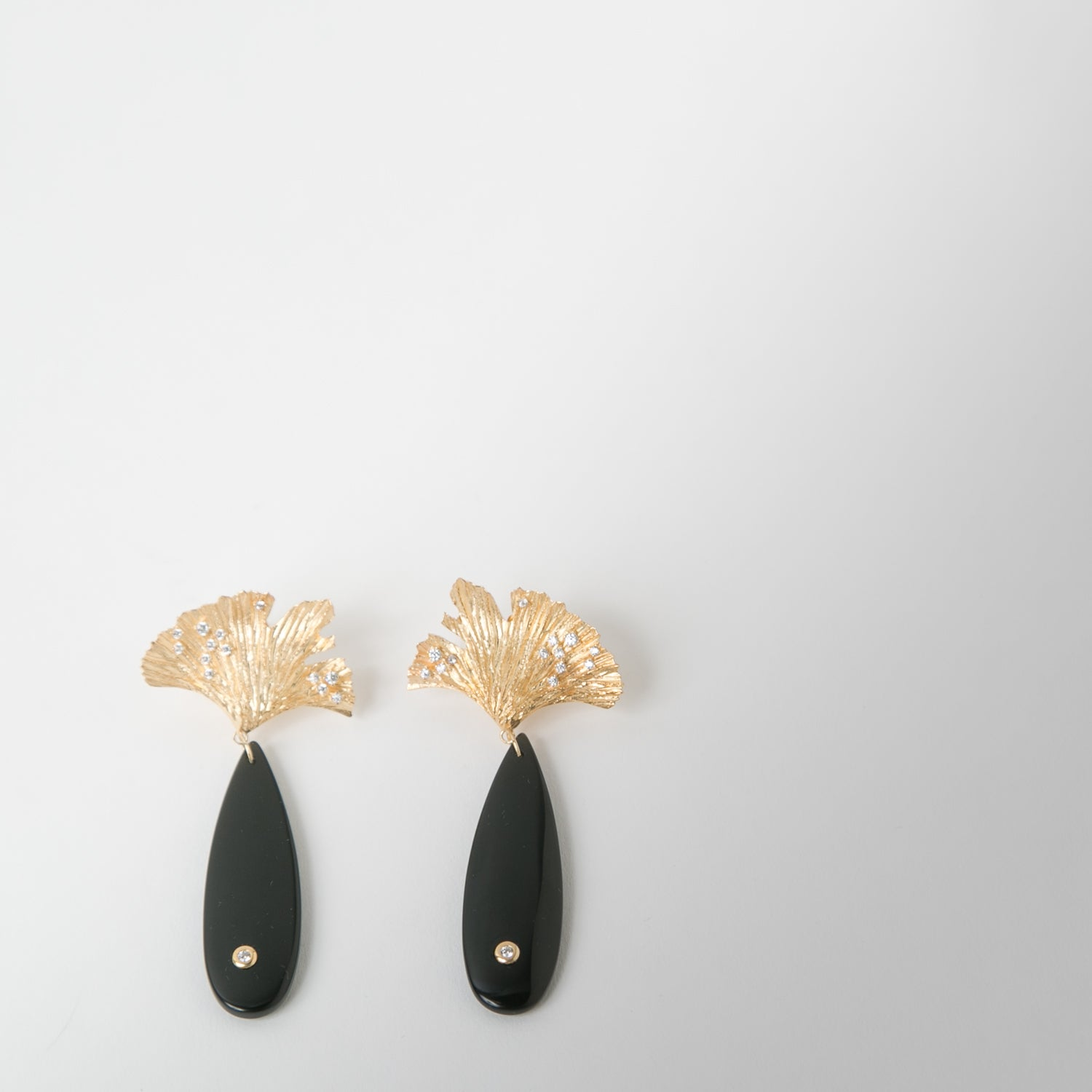 gold leaf attached to carved black obsidian finished with cubic zirconia by Apples & Figs