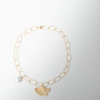 gold necklace with pearl and golden leaf by Apples & Figs