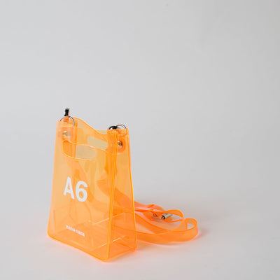 orange pvc bag at Secret Location by nana-nana