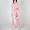 Pink pajama set with ruffles by Sleeper at Secret Location