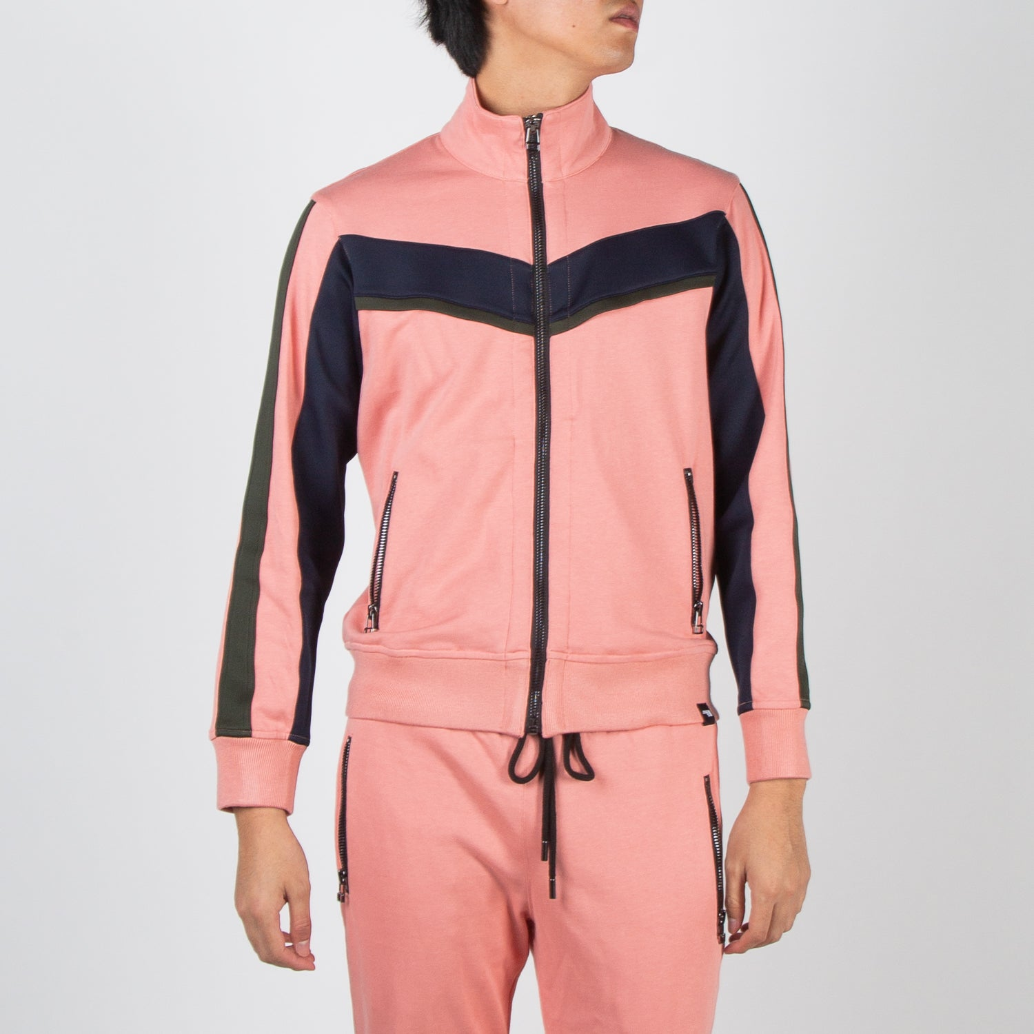 Pink track jacket by Dim Mak at Secret Location