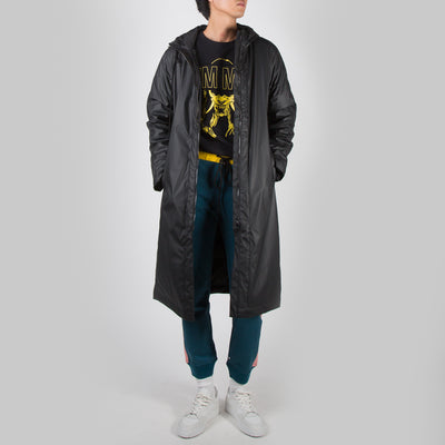 Black rubber raincoat with logo by Dim Mak at Secret Location