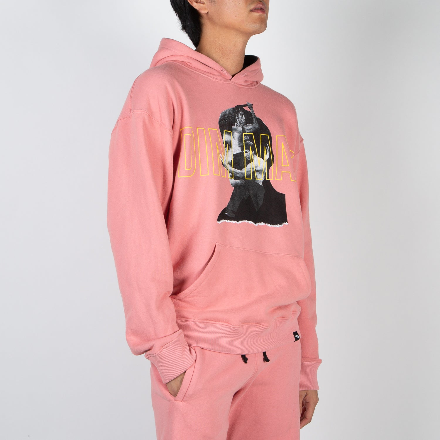 Printed Bruce Lee on pink pullover hoodie by Dim Mak at Secret Location