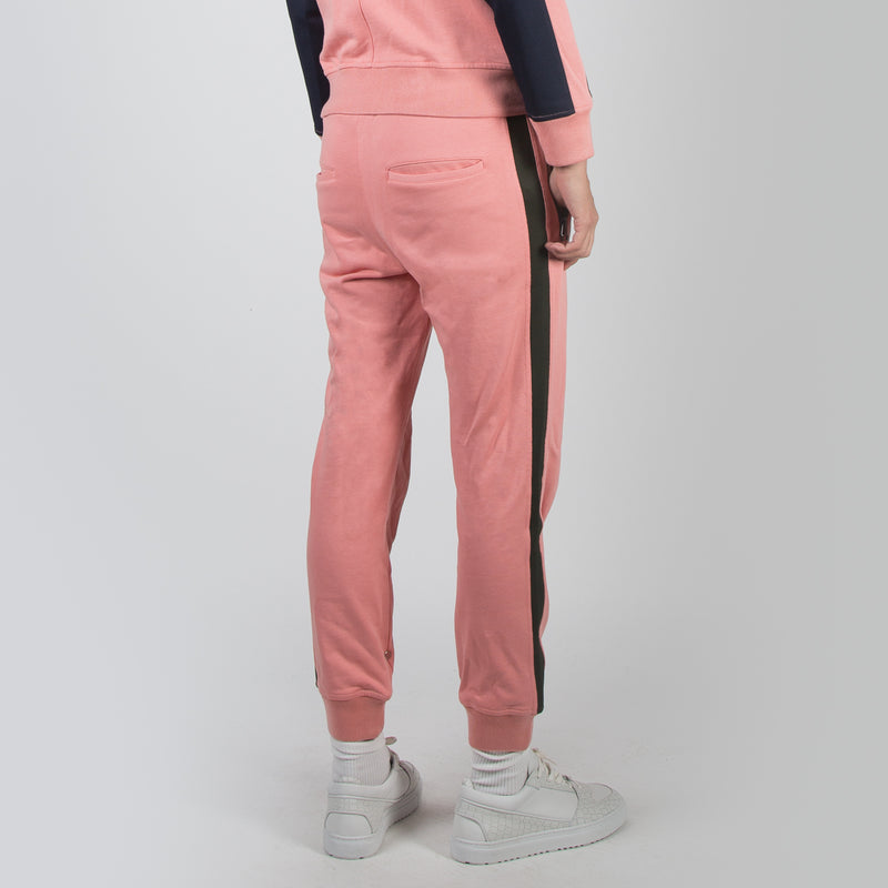 Pink coloured jogger track pants by Dim Mak at Secret Location