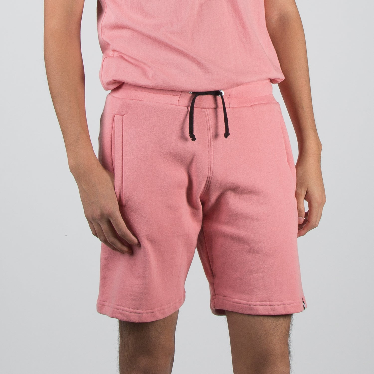 coral sweat shorts by Dim Mak at Secret Location