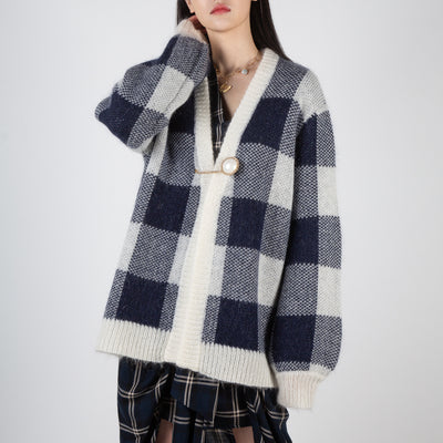 jacquard knit cardigan in plaid with large pin by Mother of Pearl at Secret Location