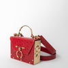 Red shoulder bag with gold hardware by Okhtein at Secret Location