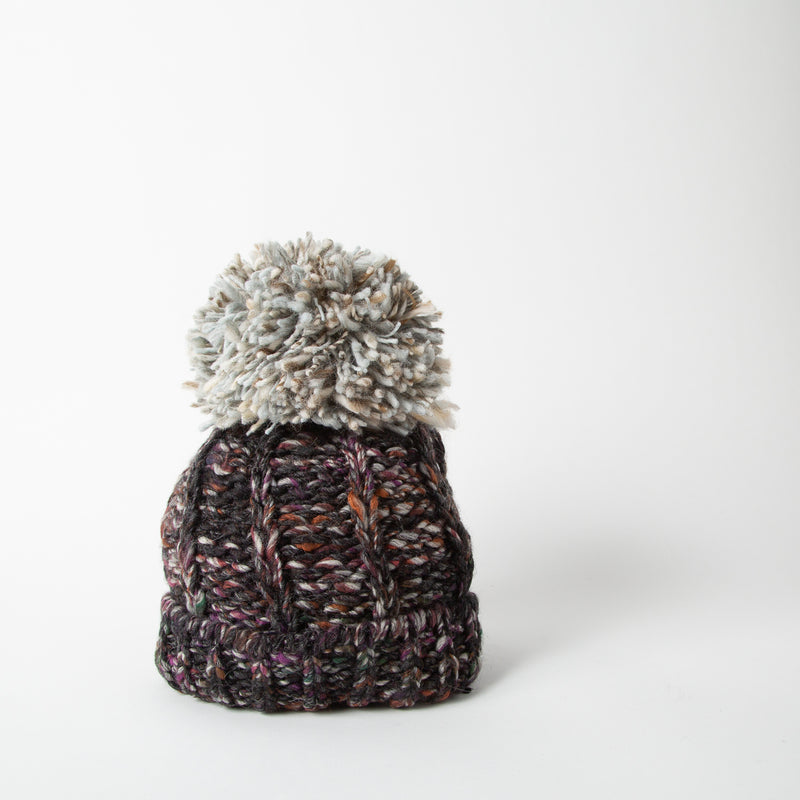 Wool blend beanie with pom-pom in black and grey by SuperDuper Hats at Secret Location