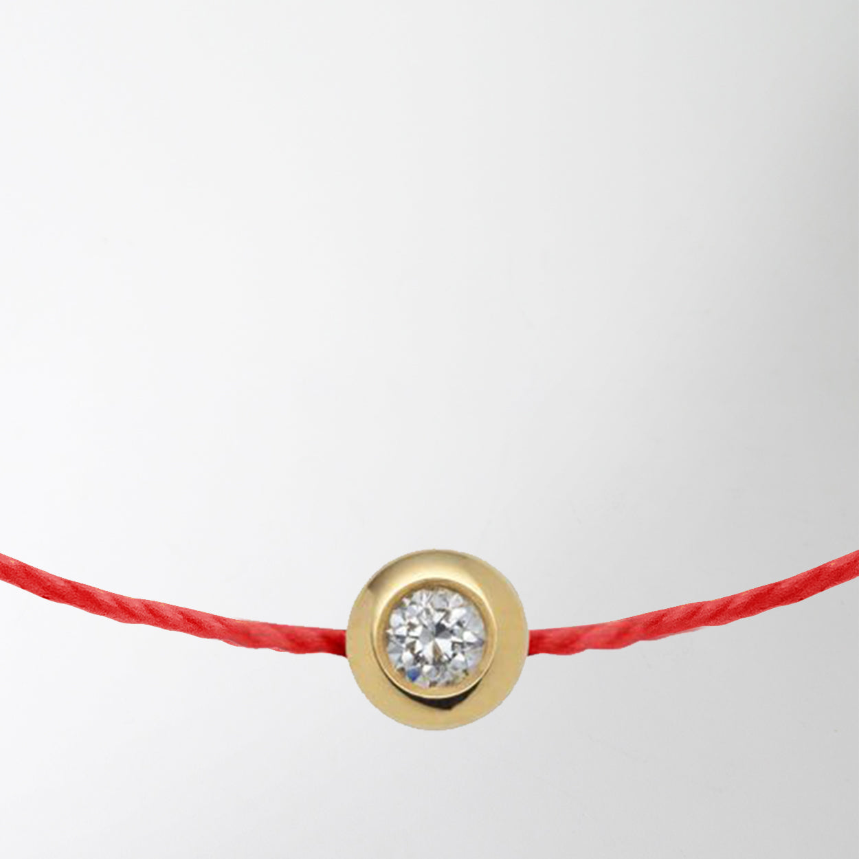 diamond charm with gold on red string bracelet by Redline at Secret Location Concept Store