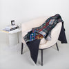 luxury wool printed plaid and floral blanket at secret location concept store