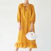 lounge linen dress dijon orange by sleeper at secret location