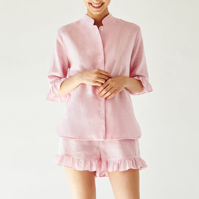 lounge linen suit in pink by sleeper at secret location