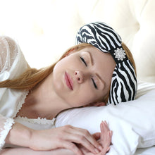 White Zebra Beauty Loop Anti-Wrinkle Pillow In Use
