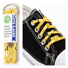 yellow shoelaces on a black converse shoe